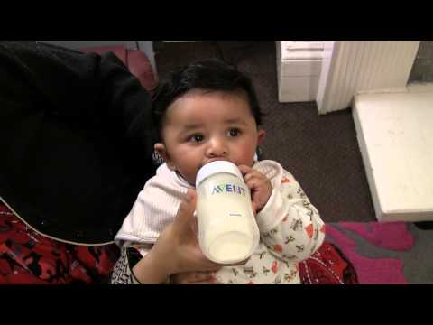 Baby drinking bottle milk - 4 months old