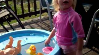 Ella playing in the water table