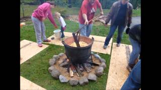 "Making apple butter in copper kettle. ""A Festive Family Tradition"""