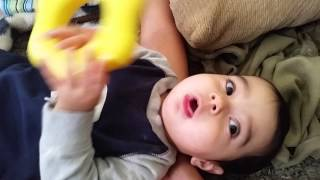 Baby Hits sleeping mom on head with plastic toy