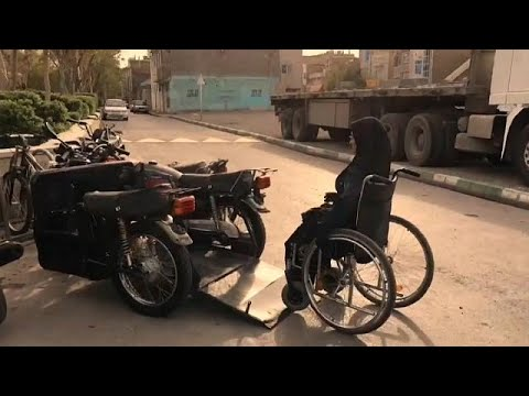 Disabled woman creates custom-made motorbike to travel in Iran