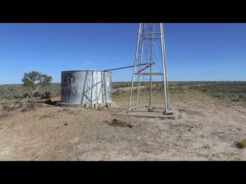 Windmill How to get water from ground in an arid climate  New Mexico for cattle, horses or humans