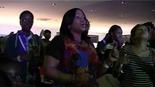 Pastor Bugembe singing Tumusinze Yesu