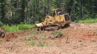 Stumping and Grubbing with a CAT 963 on an incline.
