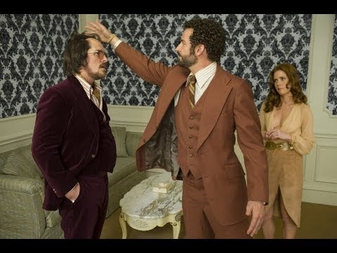 """Bradley Cooper Messes With Christian Bale's Elaborately Constructed Hair  In """"American Hustle."""""""
