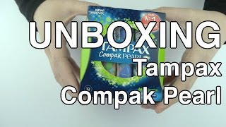 Unboxing a Tampax Compak Pearl brand tampon.