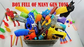 Box Full Of Many Gun Toys Shoot And Sound Playing - Colored Gun Toys