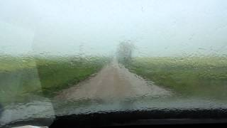 Driving a country road in the rain