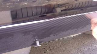 How to remove front tow eye recovery hook cover on Range Rover Sport 2010