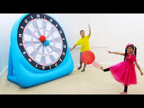 Emma and Andrew Pretend Play with Giant Inflatable Dartboard Ball Game