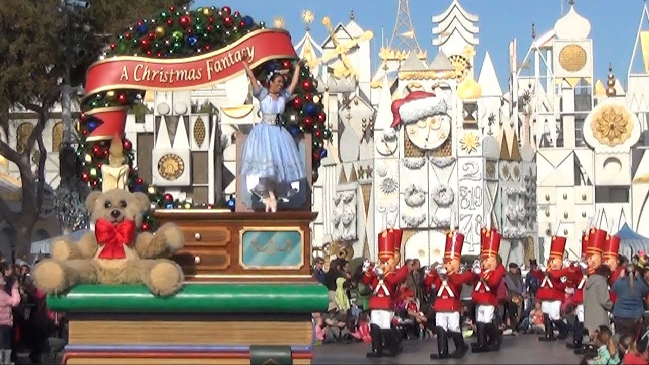 a christmas fantasy parade at disneyland daytime with its a small world background youtube