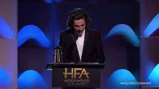 Timothée Chalamet accepts the Breakout Actor award at the Hollywood Film Awards