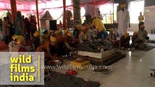 Priests reciting mantras for 'Prana pratishta' ceremony at Saisthanam temple, Dehradun