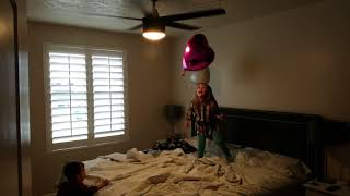 Twins and balloons and a ceiling fan means a party