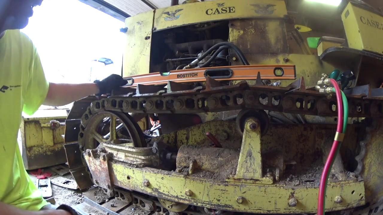 case dozer adjusting the track