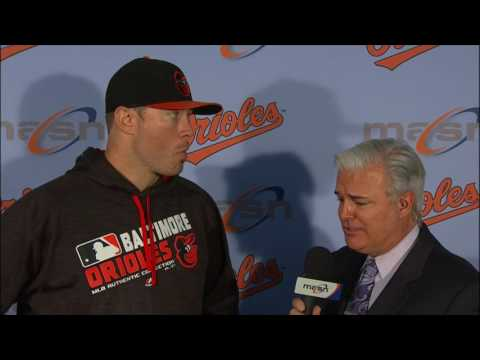 Chris Tillman talks with Jim Hunter after pitching O's 2-1 victory