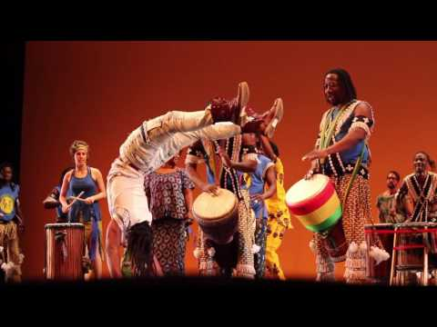 Acrobat friends spontaneously take over stage at African drum concert