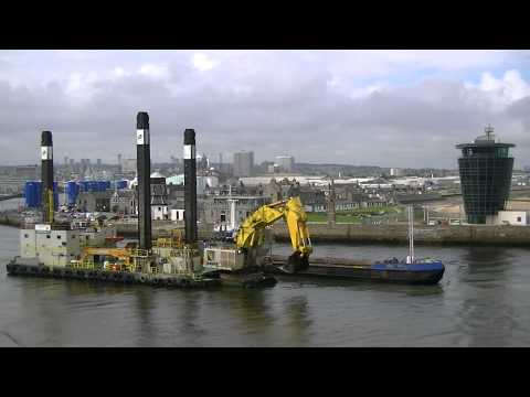 The Hans Hopper Barge Pulling up Longside the Nordic Giant in Aberdeen Harbour