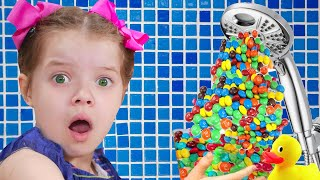 Kids Pretend play Magic Shower m&ms and more funny videos about sweets for kids from Nicole
