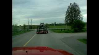 Chevy 1500 Towing A Bobcat On The Move