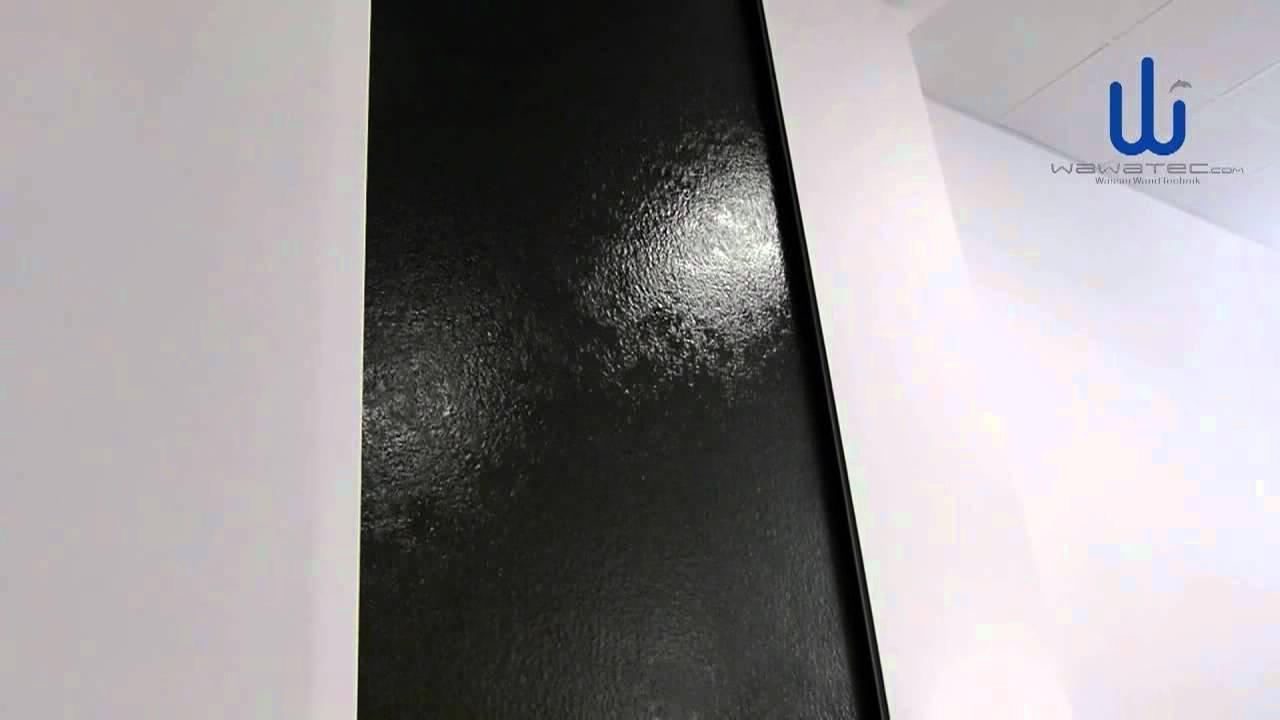 wasserfall wasserwand auf schwarzem naturstein granit bei löwe, Wohnzimmer