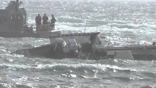 Boat runs aground on Chatham bar