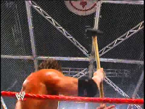 HHH hits Mr.McMahon with the sledgehammer- Unforgiven 2006