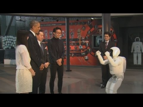 Barack Obama plays soccer with a robot in Japan