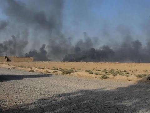 Raw: Iraq Kurdish Forces Fight IS Group