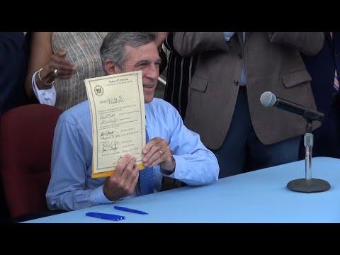 Governor John Carney signs $15 minimum wage legislation