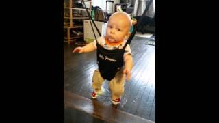 baby doing irish jig in jolly jumper
