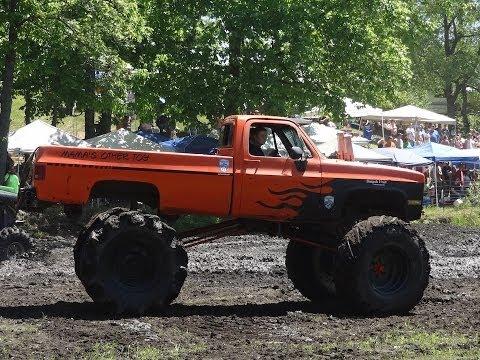 HUGE TRUCKS Mud Bogging at Perkins Mud Bog 2014  / The Movie!