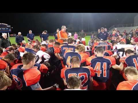 Galion football players pray following game