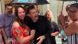 Ryan Greets Fans in the Rain