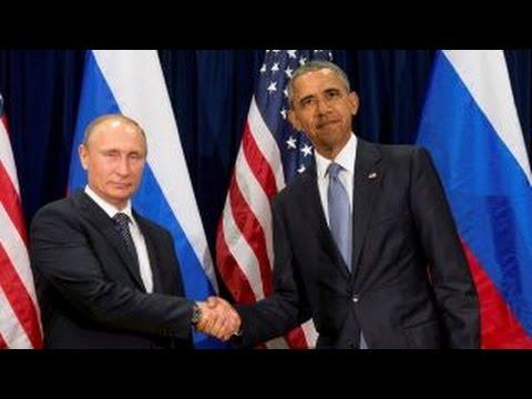 Obama warns Russia of retaliation over hacking