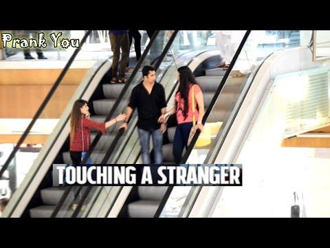 Girl Touching Strangers Hands On The Escalator Prank