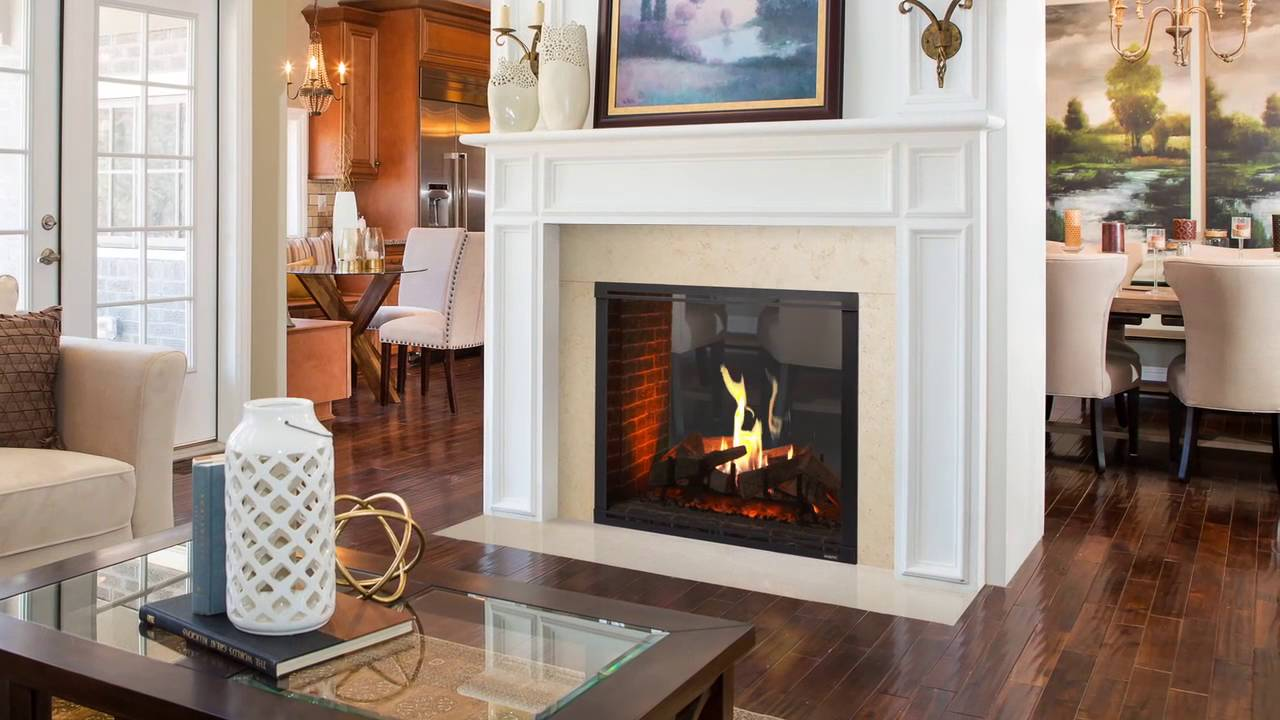 The Marquis II series gas fireplace fills your home with comfort. Watch the scene unfold with an expansive view of the flames as they wrap around split logs....