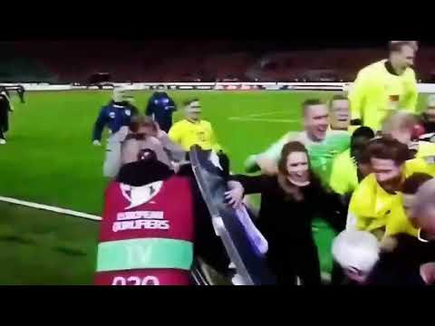 Swedish players destroy a TV set during the celebration of their qualification