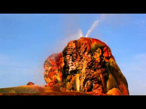 Shot of hot water spouting out of the colorful rock formation at Fly Geyser, Nevada.