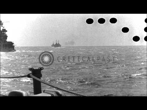 Battleships USS Colorado and USS Maryland in column with other ships at sea in Pa...HD Stock Footage