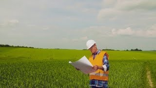 Engineer Analyzing Plan While Looking At Farm | Stock Footage - Videohive