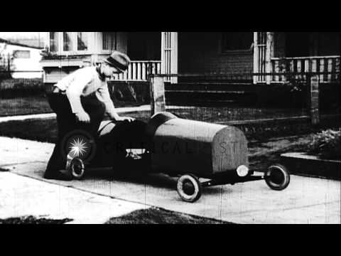 A 13 year old newspaper boy Edward Floyd makes a car and drives it delvering pape...HD Stock Footage