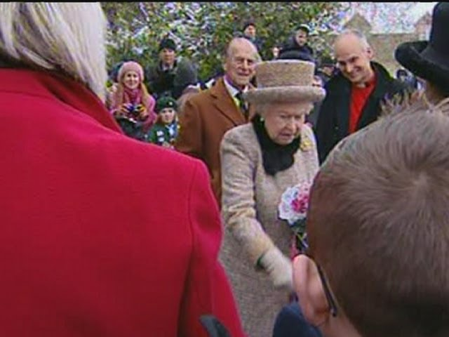 Queen Fail: Queen Elizabeth struggles to break free from over-zealous fan in Sandringham