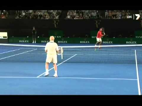 Rod Laver hitting with Roger Federer