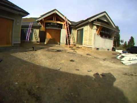 Installing flat concrete tile roofing. 8/12 slope
