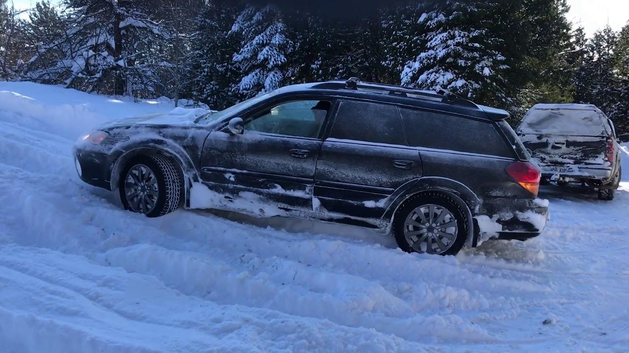 subaru outback in heavy snow