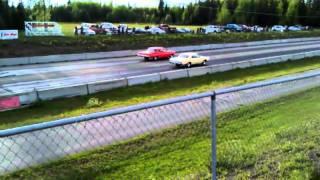 1961 Chevy Bel Air vs 1965 GTO - Drag Race