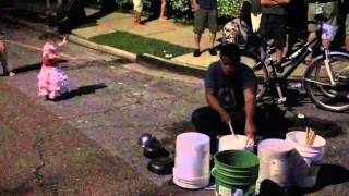 Little girl dancing to bucket drummer at New Orleans Jazzfest 2016