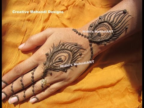 Mehndi Tattoo Peacock Feather : Stylish peacock feather morpichh back hand tattoo henna mehndi