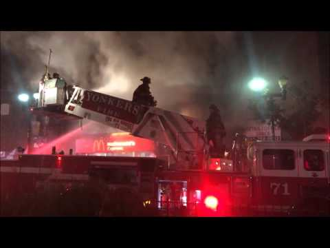 YONKERS FIRE DEPARTMENT BATTLING A 5TH ALARM FIRE ON SOUTH BROADWAY AVE. IN THE CITY OF YONKERS, NY.